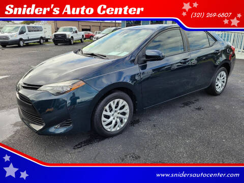 2017 Toyota Corolla for sale at Snider's Auto Center in Titusville FL