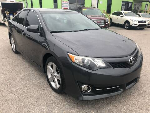 2014 Toyota Camry for sale at Marvin Motors in Kissimmee FL