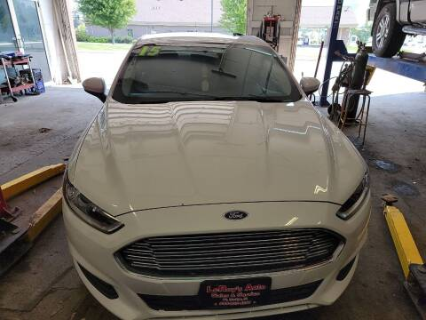 2015 Ford Fusion for sale at LEROY'S AUTO SALES & SVC in Fort Dodge IA