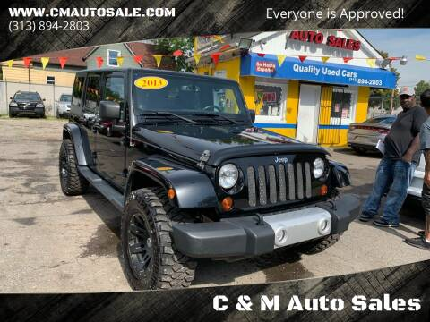 2013 Jeep Wrangler Unlimited for sale at C & M Auto Sales in Detroit MI
