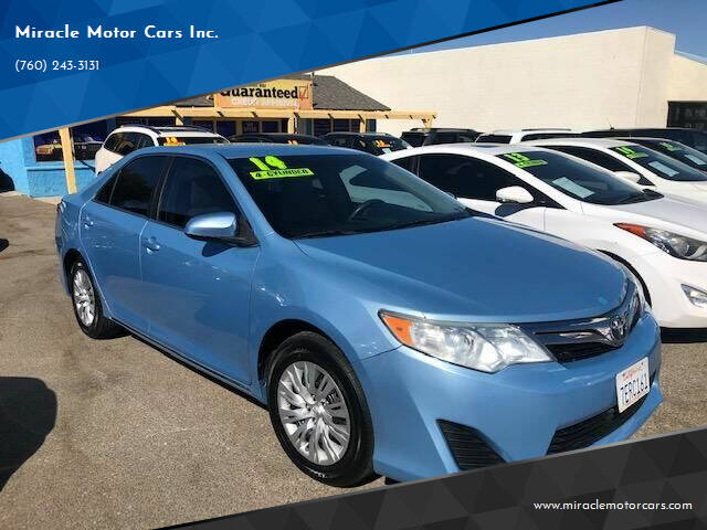 2014 Toyota Camry for sale at Miracle Motor Cars Inc. in Victorville CA