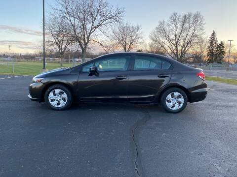 2014 Honda Civic for sale at Caruzin Motors in Flint MI