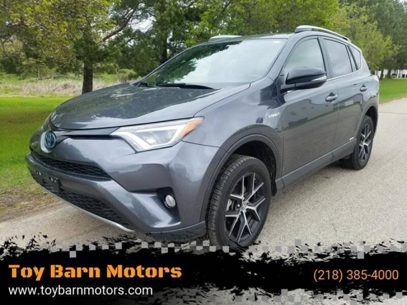 2018 Toyota RAV4 Hybrid for sale at Toy Barn Motors in New York Mills MN