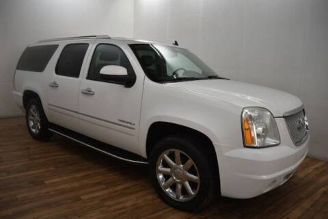 2012 GMC Yukon XL for sale at Paris Motors Inc in Grand Rapids MI