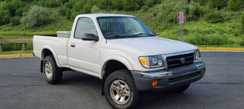 2000 Toyota Tacoma for sale at BOOST MOTORS LLC in Sterling VA