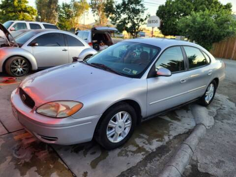 2007 Ford Taurus for sale at E and M Auto Sales in Bloomington CA