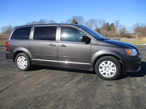 2015 Dodge Grand Caravan for sale at Crossroads Used Cars Inc. in Tremont IL