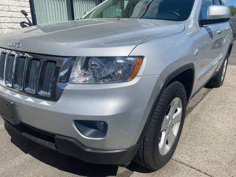 2013 Jeep Grand Cherokee for sale at Story Brothers Auto in New Britain CT