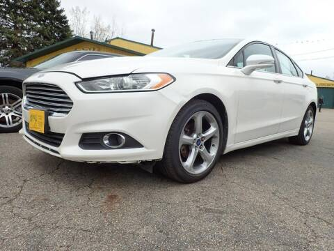 2013 Ford Fusion for sale at RPM AUTO SALES in Lansing MI