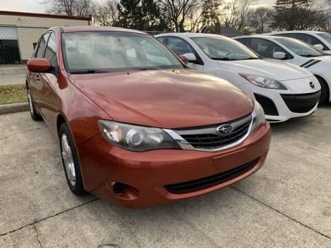 2009 Subaru Impreza for sale at Martell Auto Sales Inc in Warren MI