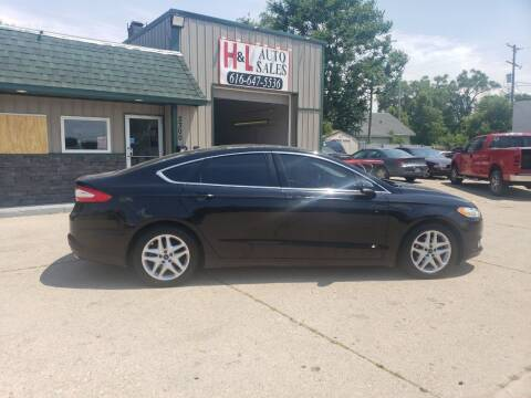 2016 Ford Fusion for sale at H & L AUTO SALES LLC in Wyoming MI