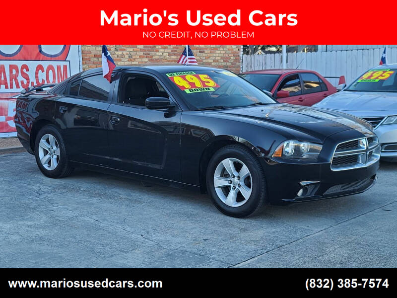 2014 Dodge Charger for sale at Mario's Used Cars - South Houston Location in South Houston TX