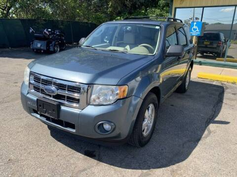 2010 Ford Escape for sale at RPM AUTO SALES in Lansing MI