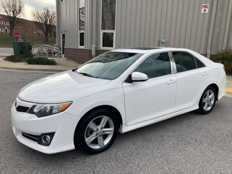 2013 Toyota Camry for sale at AMERICAR INC in Laurel MD