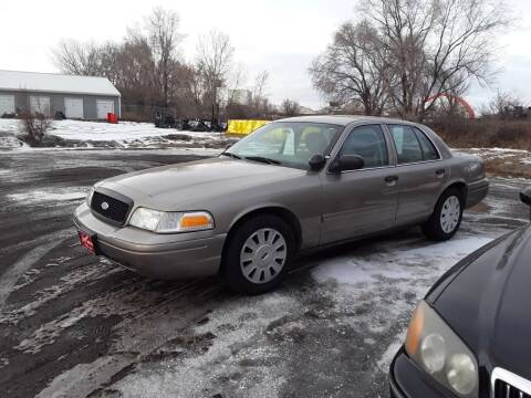 2011 Ford Crown Victoria for sale at BARNES AUTO SALES in Mandan ND