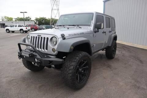 2014 Jeep Wrangler Unlimited for sale at City Auto in Murfreesboro TN