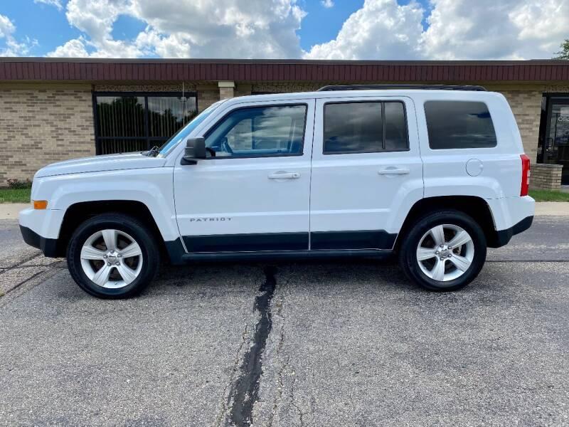 2011 Jeep Patriot for sale at Caruzin Motors in Flint MI