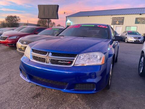 2014 Dodge Avenger for sale at BELOW BOOK AUTO SALES in Idaho Falls ID