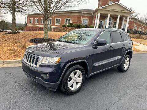2011 Jeep Grand Cherokee for sale at Two Brothers Auto Sales in Loganville GA