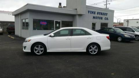 2014 Toyota Camry for sale at VINE STREET MOTOR CO in Urbana IL