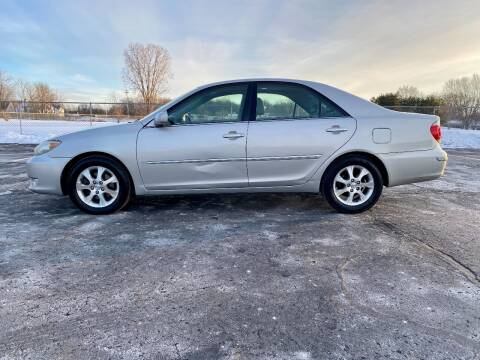 2006 Toyota Camry for sale at Caruzin Motors in Flint MI