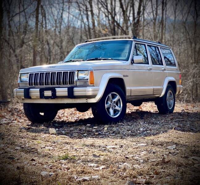 1995 Jeep Cherokee for sale at Unique LA Motor Sales LLC in Byrnes Mill MO