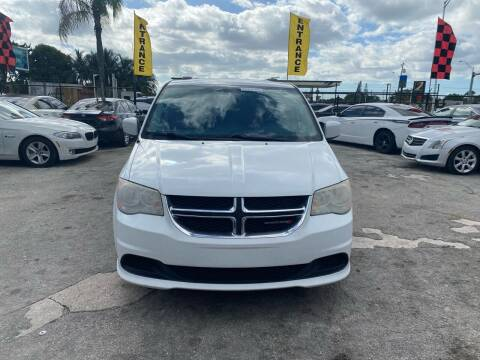 2014 Dodge Grand Caravan for sale at America Auto Wholesale Inc in Miami FL