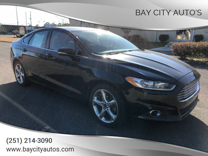 2014 Ford Fusion for sale at Bay City Auto's in Mobile AL