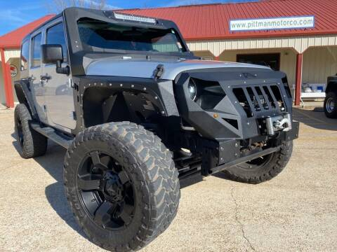 2012 Jeep Wrangler Unlimited for sale at PITTMAN MOTOR CO in Lindale TX