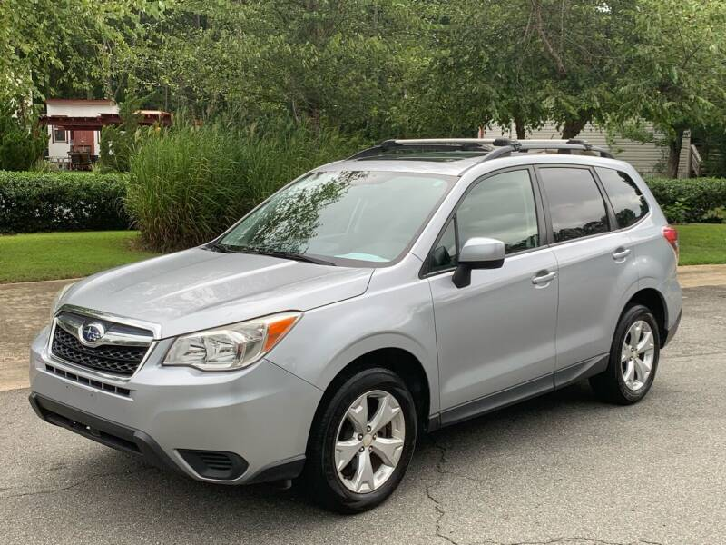 2014 Subaru Forester for sale at Triangle Motors Inc in Raleigh NC