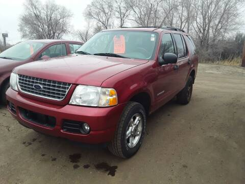 2004 Ford Explorer for sale at BARNES AUTO SALES in Mandan ND