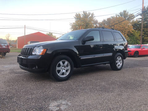 2010 Jeep Grand Cherokee for sale at Jim's Hometown Auto Sales LLC in Byesville OH