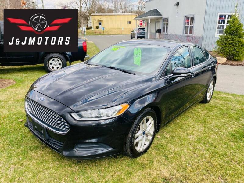 2013 Ford Fusion for sale at J & J MOTORS in New Milford CT