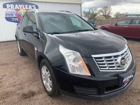 2016 Cadillac SRX for sale at Praylea's Auto Sales in Peyton CO