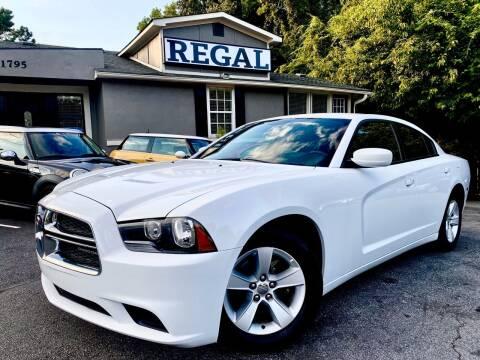 2014 Dodge Charger for sale at Regal Auto Sales in Marietta GA