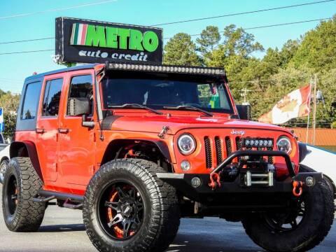 2015 Jeep Wrangler Unlimited for sale at Metro Auto Credit in Smyrna GA