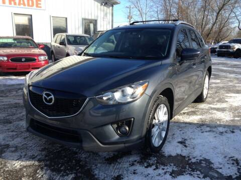 2013 Mazda CX-5 for sale at Steves Auto Sales in Cambridge MN