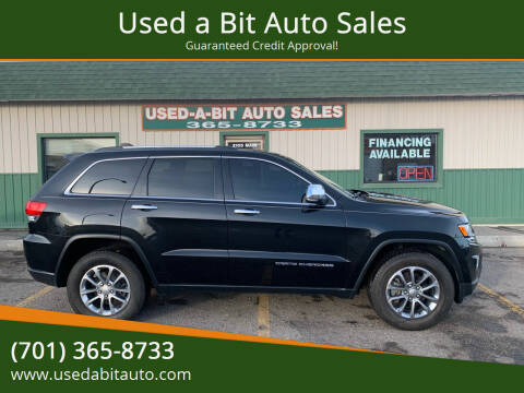 2014 Jeep Grand Cherokee for sale at Used a Bit Auto Sales in Fargo ND