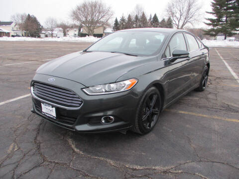 2016 Ford Fusion for sale at Triangle Auto Sales in Elgin IL