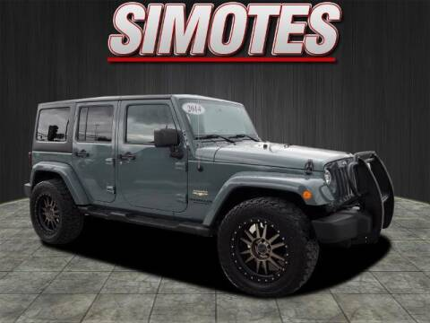 2014 Jeep Wrangler Unlimited for sale at SIMOTES MOTORS in Minooka IL