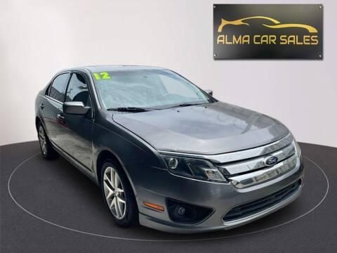 2012 Ford Fusion for sale at Alma Car Sales in Miami FL