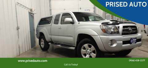 2009 Toyota Tacoma for sale at PRISED AUTO in Gladstone MI