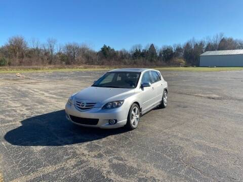 2004 Mazda MAZDA3 for sale at Caruzin Motors in Flint MI