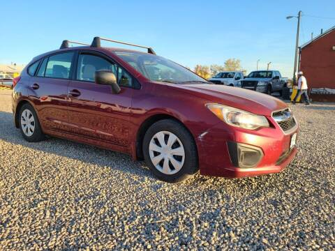 2014 Subaru Impreza for sale at BERKENKOTTER MOTORS in Brighton CO