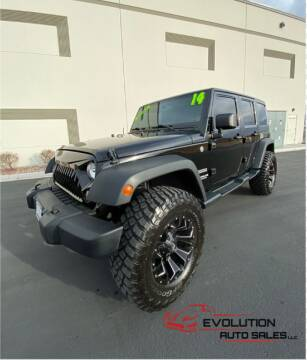 2014 Jeep Wrangler Unlimited for sale at Evolution Auto Sales LLC in Springville UT