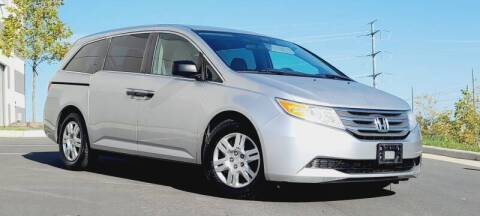 2011 Honda Odyssey for sale at BOOST MOTORS LLC in Sterling VA