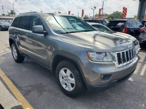 2012 Jeep Grand Cherokee for sale at America Auto Wholesale Inc in Miami FL