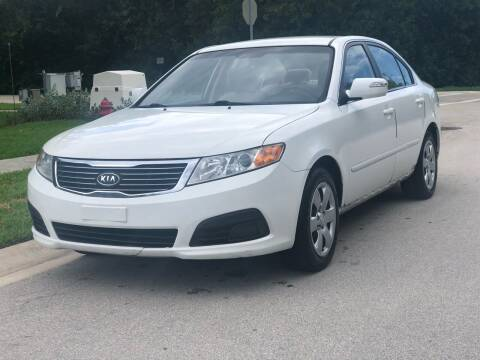 2010 Kia Optima for sale at L G AUTO SALES in Boynton Beach FL