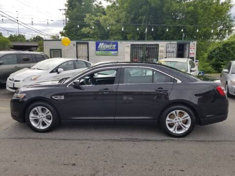 2015 Ford Taurus for sale at Howe's Auto Sales in Lowell MA