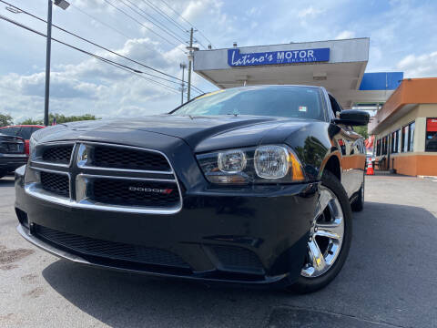 2014 Dodge Charger for sale at LATINOS MOTOR OF ORLANDO in Orlando FL